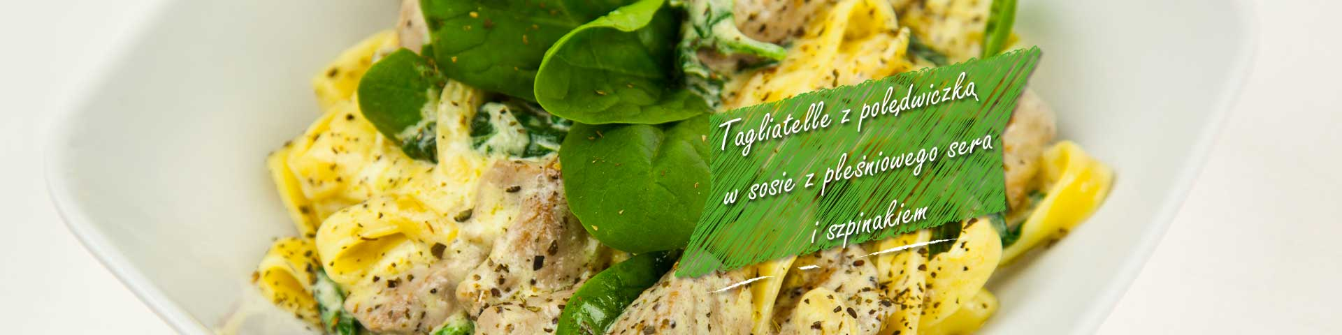 Tagliatelle with pork loin and spinach in a blue cheese sauce